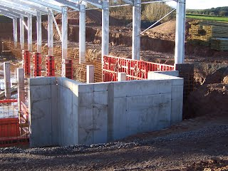Mixing point under construction extending beyond slurry tank